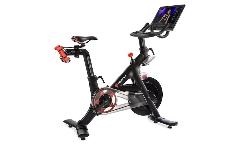 The Peloton bike features a touchscreen display for real-time interactivity